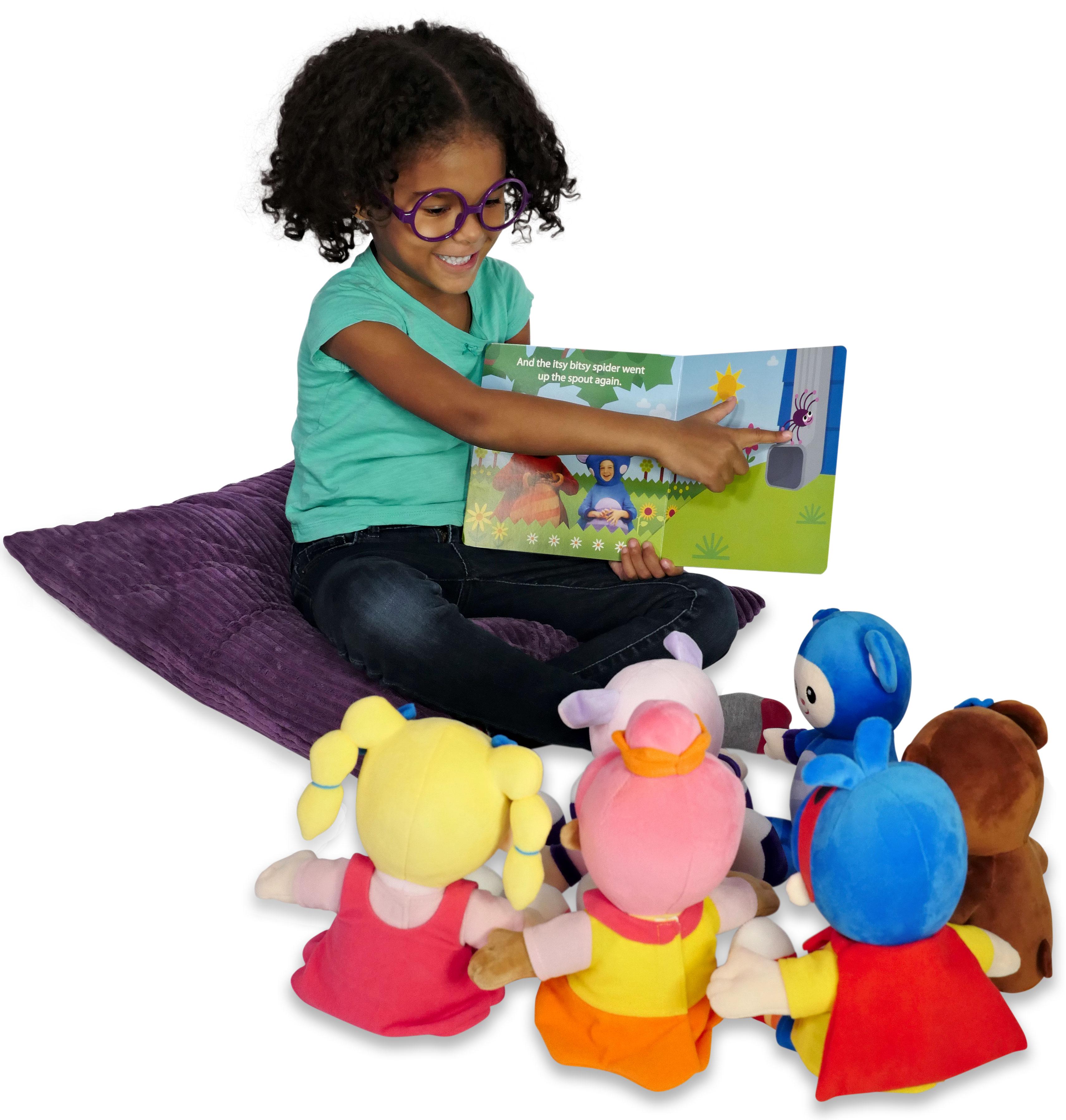 Girl reading to plush