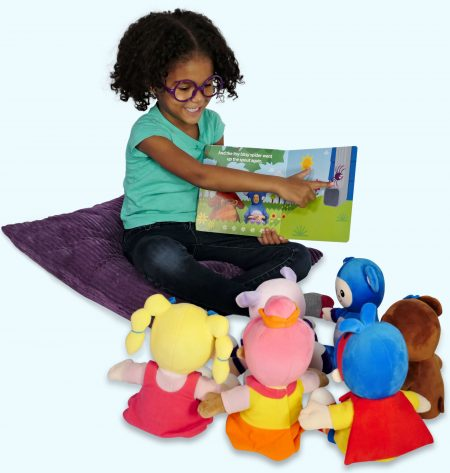 Girl reading to plush